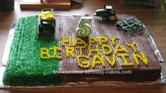 Homemade Tractor Birthday Cake: I did this tractor birthday cake for my 5 year old son's birthday.  He loves tractors and John Deere.  The cake is made of 2 oblong cakes put together.