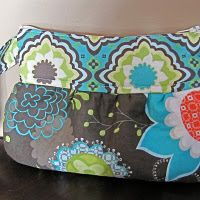DIY Scrappy Clutch. I bet you could take this same idea and turn it into a big purse...