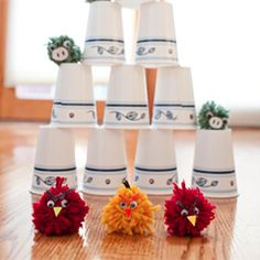 Keep kids busy by making this simple angry birds game using yarn pom poms and dixie cups.