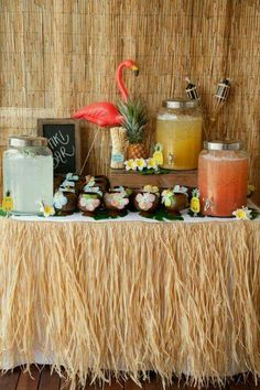 Put short hula skirts on the wall behind the drink station