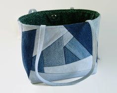 Tote bag, handbag or shoulder bag/purse made out of a variety of upcycled recycled repurposed denim blue jeans and cotton fabric was used to
