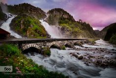 Låtefossen Vin by kaizross  bridge låtefossen mountain norway odda pano river sunset travel waterfall Låtefossen Vin kaizross