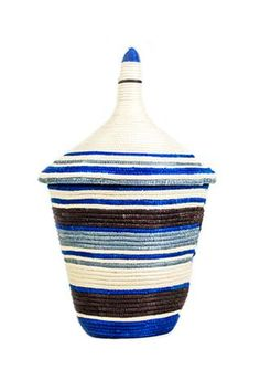 Woven from fibers harvested from the sisal leaf, Rwanda's women learned to weave these beautiful baskets at the hand of their mothers and grandmothers. This beautiful handcrafted cathedral basket has been a part of the Rwandan culture for centuries serving as home décor, wedding gifts, baby welcoming gifts and storage containers. Woven over the course of 2-4 days, women are able to earn an income that substantially provides for their family.