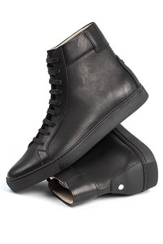 """The Logan """"Blackout"""" is our minimal high-top trainer, which emphasizes focus on pattern simplicity, unique height and a monochromatic color pallet. Our footbed"""