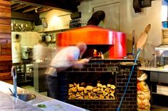 Burrata's attention to detail is also the focal point of the restaurant. The pizza oven was hand built by a third-generation family-owned business in Naples. This oven is able to reach higher temperatures than the average pizza oven, which means every pizza turned out by Burrata is delicious and cheesy – bubbling with taste and moisture and almost impossible to resist. Biscuits, Oven, Old Things, Kitchen Appliances, Naples, Third, Restaurants, Pizza, Detail