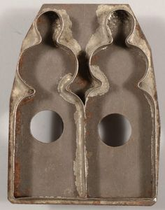 A Rare Twin Amish Girls Tinned Cookie Cutter.