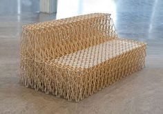 Couch made of 8,000 chopsticks, expand and contracts into different shapes and supports up to three people. Amazing!