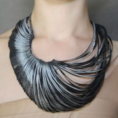 """fine cut necklace made from soft rubber threaded into chain and finished with a sweep of subtle bronze - by """"Ware"""", London (Emma Ware)"""