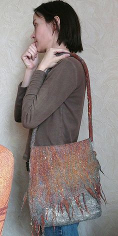 The bag does not have to be all felt ,you can make the bag bit out of heavy silk and the flap from felt