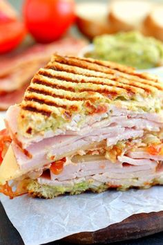 This Turkey, Bacon and Guacamole Panini is loaded with sliced turkey, creamy guacamole, Havarti cheese, bacon and tomatoes! A buttery and toasty grilled cheese sandwich stuffed with cool and creamy guacamole, crispy bacon and melted jack and cheddar cheese. The crunchy crumbled tortilla chips in this grilled cheese pay tribute to the classic combination of tortilla chips and guacamole dip. #Bacon #GuacamoleGrilled #Cheese #Sandwich