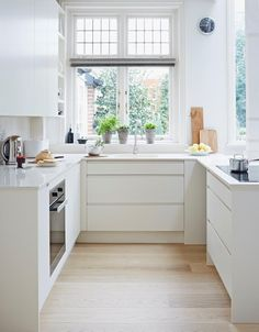 Pure handleless kitchen from John Lewis of Hungerford, shown here in Pure White. http://www.john-lewis.co.uk/kitchens/contemporary-pure-kitchen