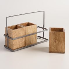 Organize your forks, knives and spoons in this stylish caddy with a modern industrial touch. Featuring a metal holder in a pewter finish, our caddy has three removable wood boxes and brings a rustic look to your table.