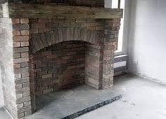 brick around free standing cast iron fireplaces Brick Fireplace