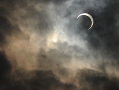 An annular solar eclipse is seen through the clouds in Kawasaki, surburban Tokyo, May 21, 2012. (Toru Yamanaka/AFP/GettyImages) #