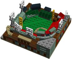 Behold a MASSIVELY detailed Mini Fenway Park model made entirely from LEGO bricks that you need Red Sox Fans! This model includes 252 LEGO bricks and ships un-assembled with printed, color instructions that provide an easy step by step guide to build a LEGO Fenway!  This is the perfect gift for any Red Sox fan or LEGO fan. This LEGO model is housed on 1 solid LEGO plate measuring 5 inches by 5 inches- making it the perfect size to to display on your desk, mantel or anywhere else you house…