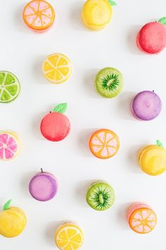 Dress up store-bought macarons with food markers and chocolate sprinkles. Or, go all out, and bake the macarons from scratch before decorating. Beaux Desserts, Cute Desserts, Cute Food, I Love Food, Cute Fruit, Comida Disney, French Macaroons, Fruit Party, Fruit Dessert