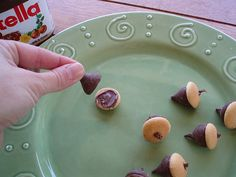 no way, this is too cute. Edible acorns! Mini-nilla-wafers, kisses and nutella