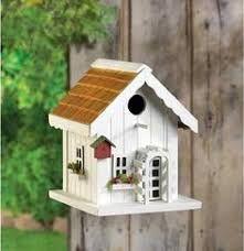 Resultado de imagen para casas de passarinho em mdf