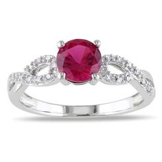 <li>Round-cut created ruby and white diamond engagement ring</li><li>10-karat white gold jewelry</li><li><a href='http://www.overstock.com/downloads/pdf/2010_RingSizing.pdf'><span class='links'>Click here for ring sizing guide</span></a></li>