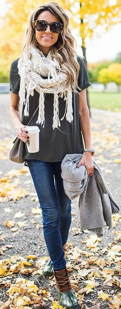 grey tee, blue jeans, a white fringe scarf, duck boots