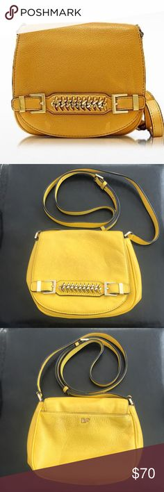 DVF Iggy Saddle Bag Super cute DVF Iggy Saddle bag! Bright yellow to compliment any outfit. Back phone pocket and inside pockets to accommodate you on the go. Small signs of wear reflected in price. You will LOVE this bag! Diane Von Furstenberg Bags Crossbody Bags