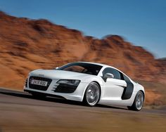"""The Audi R8.- instant driver control- xenon headlights with LED running light for the day.  19 """" alloy wheels makes this lightweight, athletic and powerful!"""
