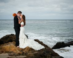 A romantic beach wedding photo from Timothy J. Photography
