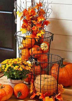 Wire baskets hold pumpkins and fall leaves in an easy fall display.