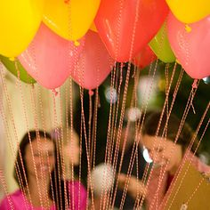 bright balloons with twine