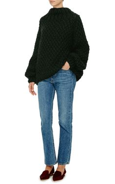 This **I Love Mr. Mittens** sweater features a moss green wool construction, yoke neckline, and knit cuffs.