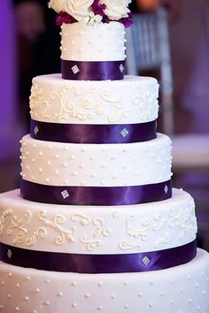 Beautiful purple ribbon cake, love this, but with red ribbon & maybe silver designs