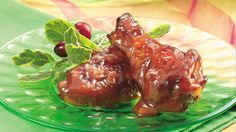 Tart cranberry and zesty barbecue sauces quickly coat chicken wings for a finger-licking-good snack.