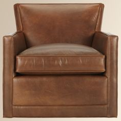 Rudy Swivel Leather Chair. In front of fireplace.
