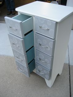 Painted with DIY chalk paint. White Dove-Benjamin Moore. Tropical Oasis and Steel Gray-Valspar. Diluted the colors with white to create an ombre effect. Sealed with paste wax. Stencil from Hobby Lobby.  Love!