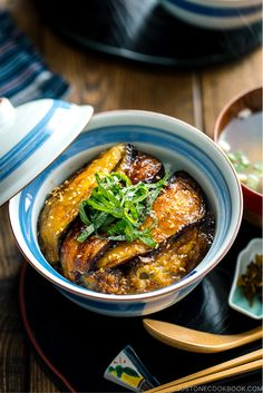 With thinly sliced eggplant seared till golden brown and coated with sweet soy sauce this Soy-Glazed Eggplant Donburi is an incredibly delicious Japanese vegan rice bowl dish Just 30 minutes start to finish Easy Japanese Recipes at JustOneCookbook Japanese Vegetarian Recipes, Easy Japanese Recipes, Asian Recipes, Ethnic Recipes, Japanese Eggplant Recipes, Japanese Rice Bowl, Japanese Food, Asia Food, Rice Recipes For Dinner