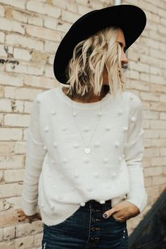 pom pom sweater, boutique style, styling sweater, cream sweater, sweater outfit, button fly jeans, button fly denim, styling black hat, street style, fall fashion, fall style, fall style 2017