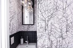Bold and graphic can still have a natural frame of mind. Stark black and white branches in a small bathroom add lots of movement to the space.