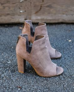 In love with our chic Accent peep Toe Bootie! Perfect for any outfit! A faux suede peep toe bootie with a stacked heel in this taupe hue that's perfect for fall. A cushioned insole and non-skid rubber