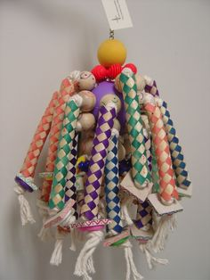 I love this idea - a whiffle ball base, with rope thread through finger traps and wood pieces!