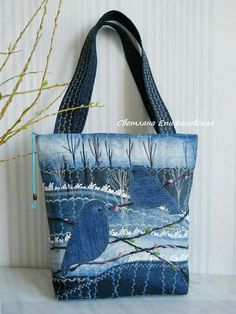 Denim bag accentuated with embroidery, lace and ribbon rosesconcept idea for denim bag Easier to paint than sew, howevBlue Bird in a winter scene.This Pin was discovered by SidTurn denim into a work of art very interesting upcycled denim applique bag by a Sacs Tote Bags, Denim Tote Bags, Denim Handbags, Denim Purse, Denim Skirt, Patchwork Denim, Patchwork Bags, Quilted Bag, Denim Quilts