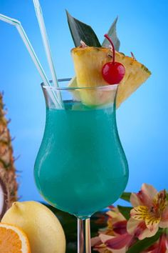 Blue Hawaii Cocktail (* 3/4 oz. Light Rum  * 3/4 oz. Vodka  * 1/2 oz. Blue Caracao  * 3 oz. Pineapple Juice  * 1 oz. Sweet & Sour Mix)