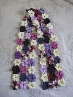Puff Flower Scarf - Meladora's Free Crochet Patterns & Tutorials @ Sarah Diltz remember all those pastel skeins the little ones?? Yup this is what their about to become!!!!!!
