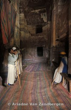 Ethiopia, Eastern Tigray, Gheralta, Debre Tsion rock hewn church, people praying in the main carved room
