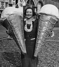 Woman holding two advertising Antarctic Ice Cream cones, 1930s