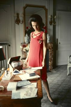 Princess Lee Radziwill in Dior's coral day dress, photo by Mark Shaw at her home in London for feature in McCall's magazine, 1960