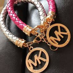 "MIchael Kors Silver Hot Pink Bracelets-Set NWOT Set of 2 MIchael Kors braided leather bracelets. Hot pink and silver with gold clasp and gold MK charm. Bracelet measures 8""-9"" depending on where it's fastened. Bracelet are brand new without tags and have never been worn. These were one of those Christmas gifts that just wasn't my style. Michael Kors Jewelry Bracelets"