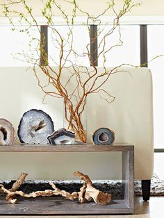 Oversize cut agates add texture and depth to a vignette or bookshelf display. Pairing these elegant natural finds with a thick, twisty tree branch and vase filled with freshly cut, winding twigs adds another dimension of natural appeal and texture.