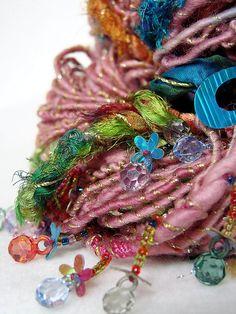 Hand Dyed, Hand Spun Art Yarn Medium: Merino fibre, metallic thread, exotic embellishments, sari silk Art Yarn - Candy O Spinning Wool, Yarn Stash, Silk Art, Ribbon Art, Fabric Beads, Textiles, Yarn Projects, Free Knitting, Textile Art
