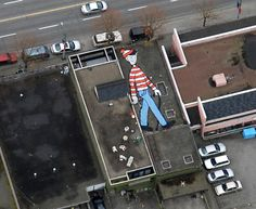 A huge hidden painting on a rooftop was created as a viral game that appears on Google Earth. Melanie Coles, Vancouver, Canada.