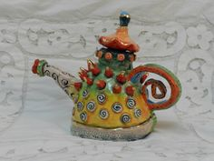 Ceramic - made from clay. hand-painted with under glazes  decorated with gold